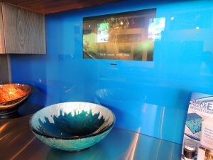 custom glass kitchen wall with TV